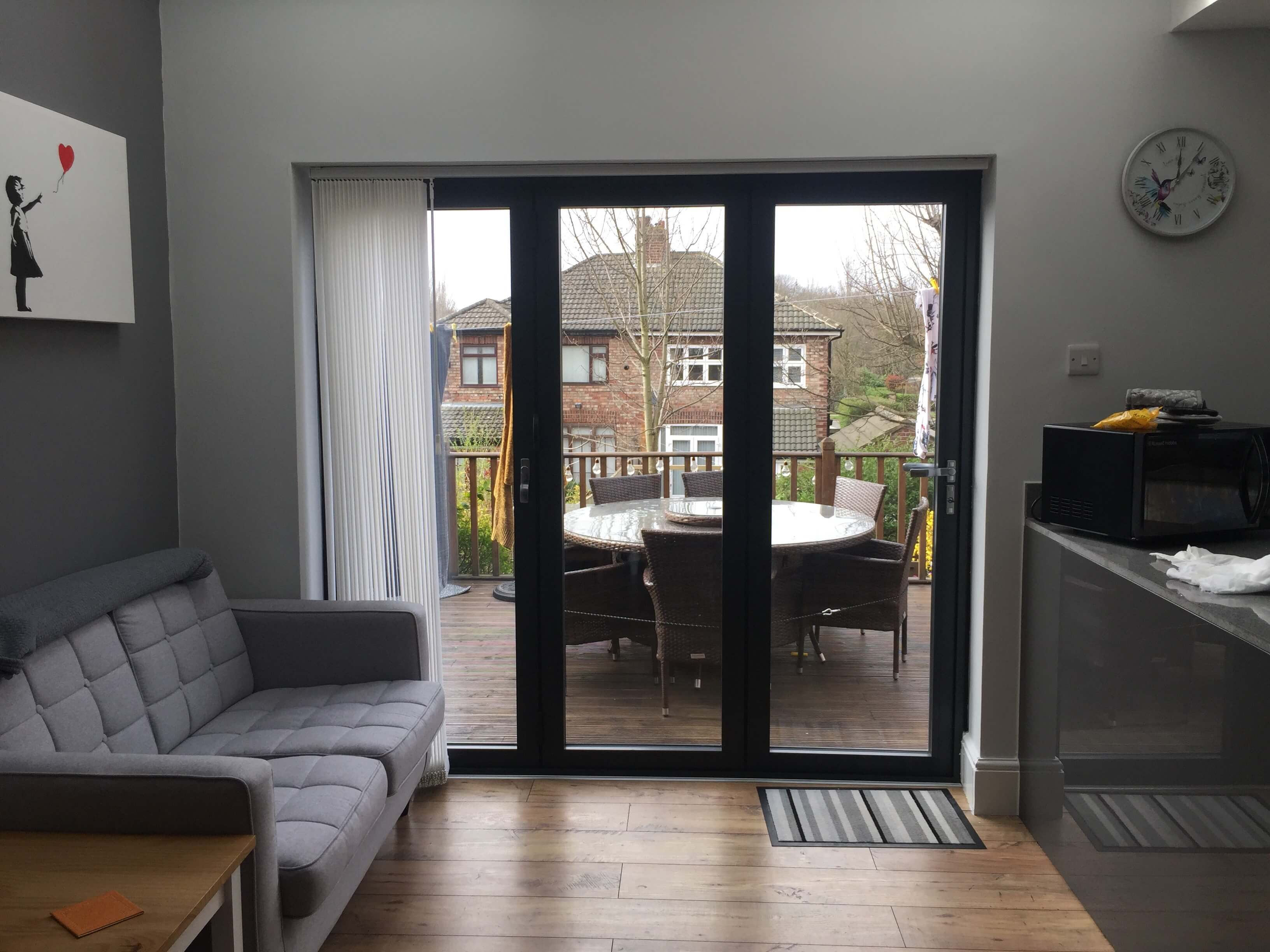 This image shows the internal look of a 3 pane aluminium bi-fold door in Anthracite Grey in Formby, Merseyside.