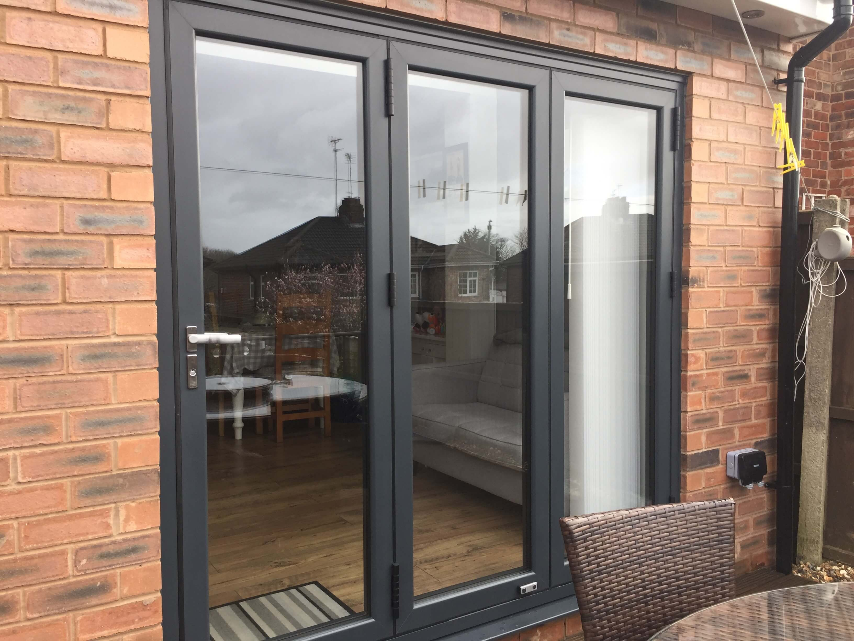 This image shows a 3 pane aluminium bi-fold door in Anthracite Grey in Formby, Merseyside.