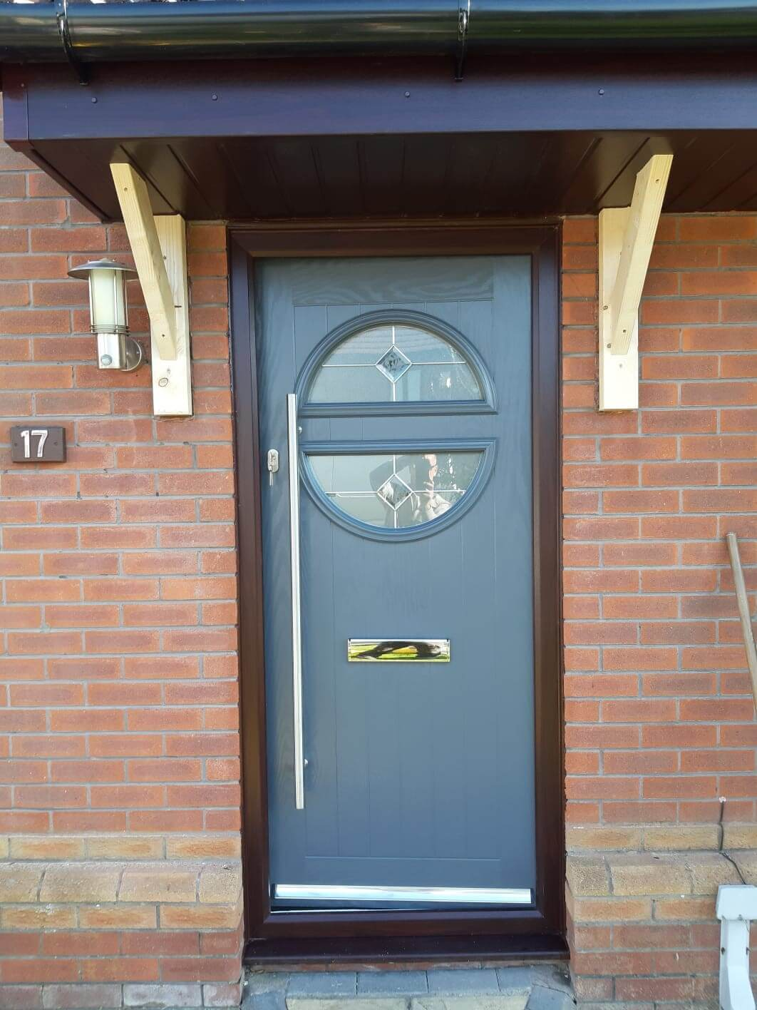 This image shows a composite door with a long pull handle in stalled by Celsius Home Improvements for customers in Liverpool.