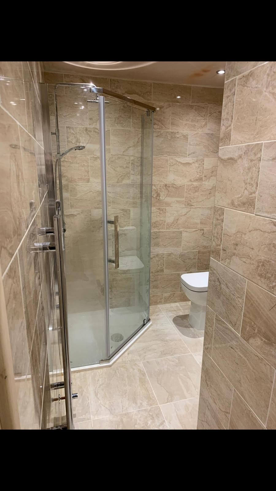 This image shows the new tiling and entrance to a bathroom renovation completed by Celsius Home Improvements in Liverpool.