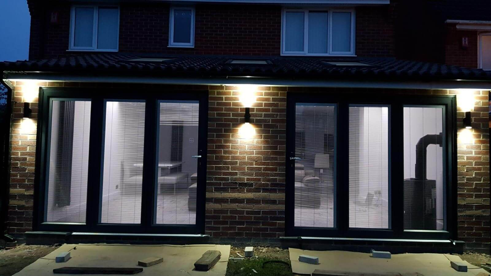 This image shows two sets of Aluminium Bi-fold doors installed on an extension in St Helens, Merseyside.