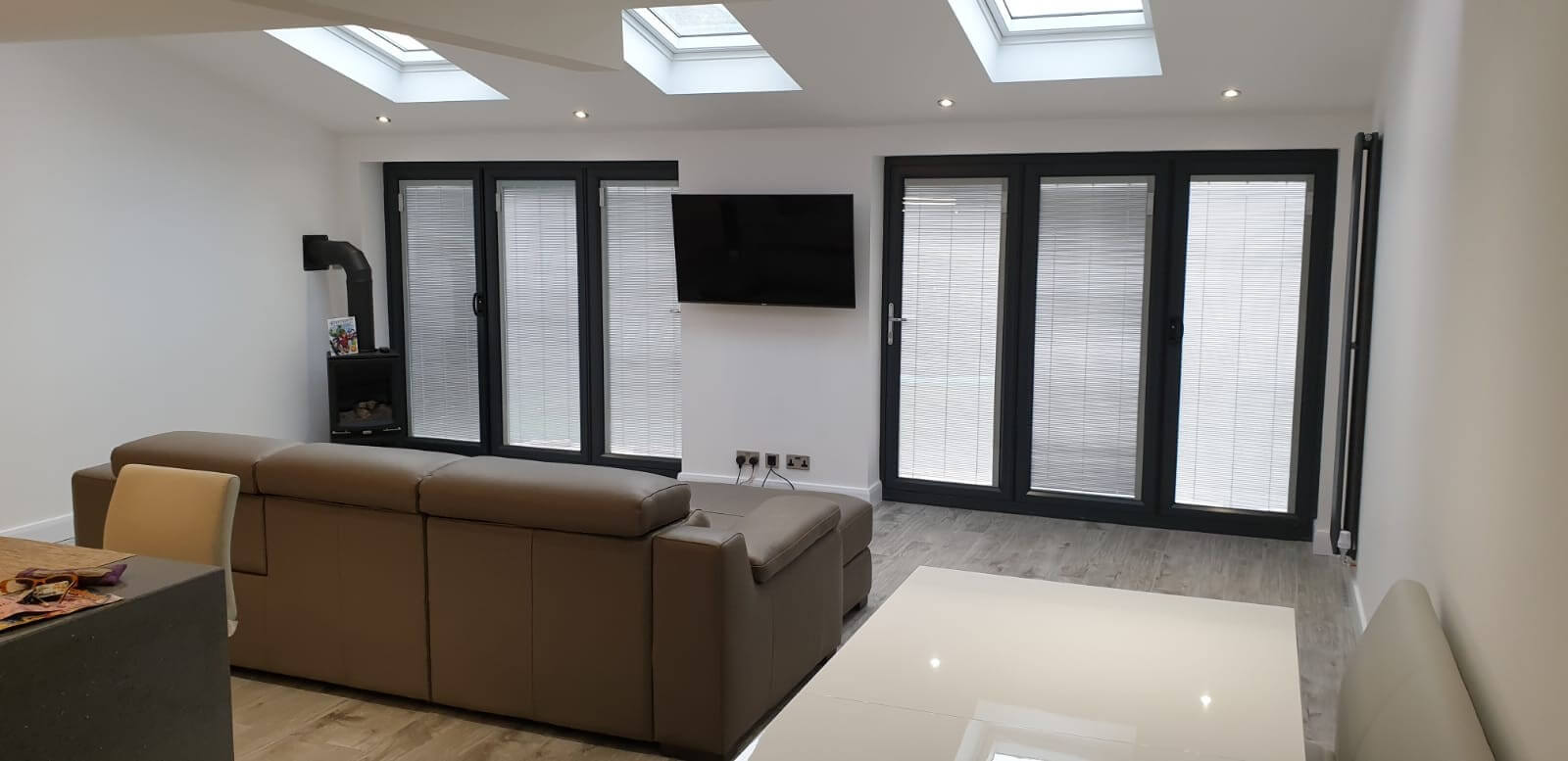 This image shows the living area of a kitchen extension with two 3 pane Bi-Folds in St Helens, Merseyside.