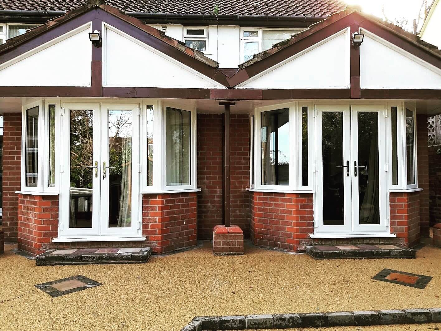 this image shows the finished installation of twin bay windows and French patio doors in Woolton, Liverpool.