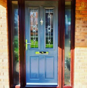 This image shows a light blue composite door installed in Liverpool.