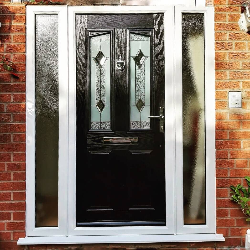 This image shows a black composite door installed in Birkdale, Southport.