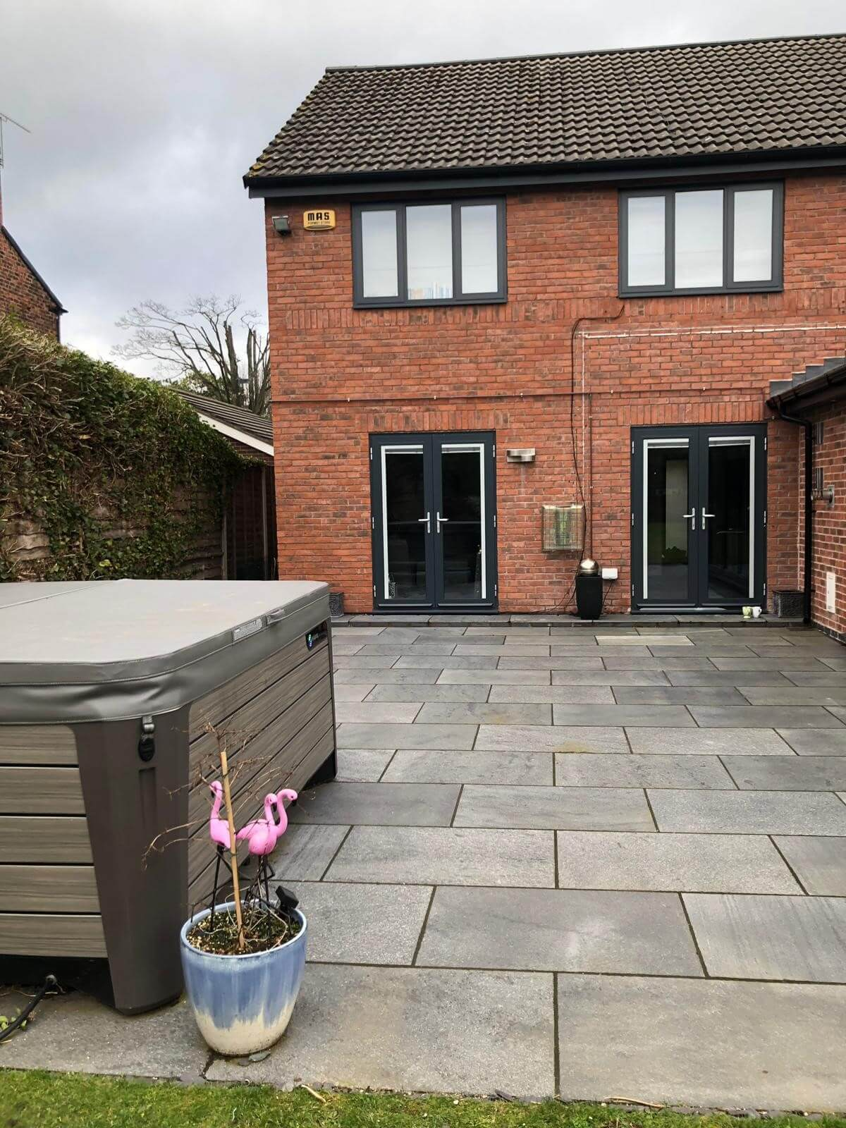 This image shows 2 new windows and 2 patio doors in aluminium and anthracite grey installed by Celsius Home Improvements at a home in Aughton, Ormskirk.
