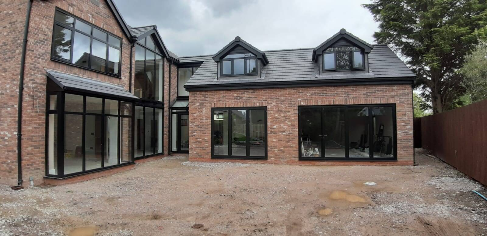 This Image shows a new build home where Celsius Home Improvements installed all of the aluminium windows and bi-fold doors. The property is in Aughton, Ormskirk.