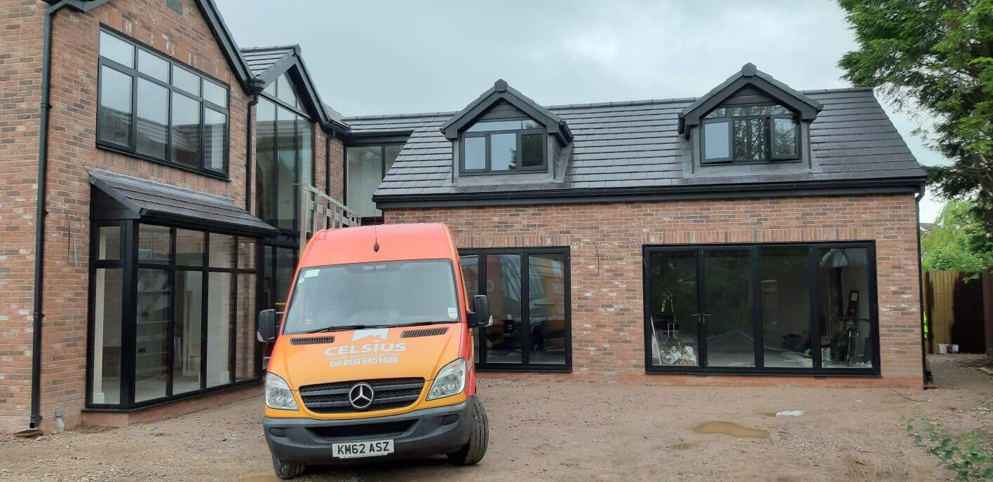 This Image shows a Celsius Home Improvements van in front of a new build home where Celsius Home Improvements installed all of the windows and doors. The property is in Aughton, Ormskirk.